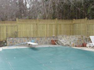 A board-on-board privacy fence design with lattice top